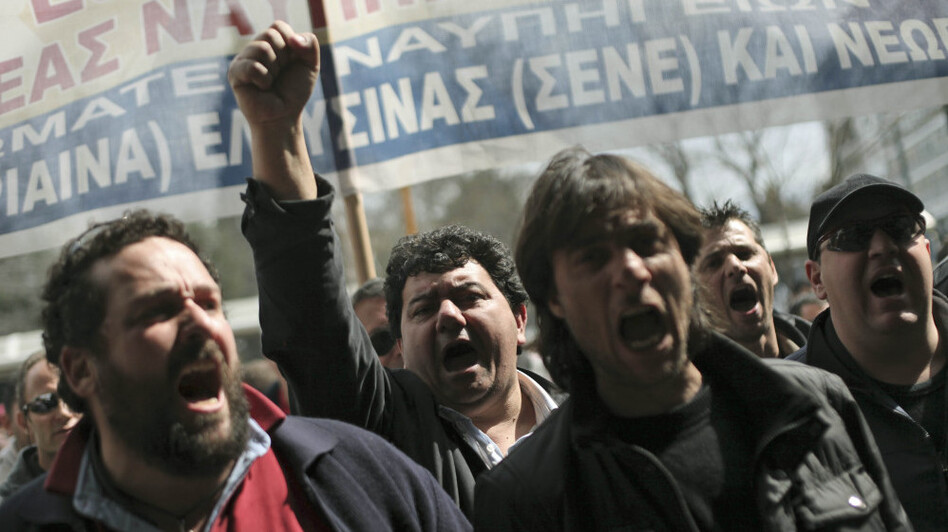 Shipyard workers demand their unpaid wages in central Athens on Thursday, the day that countries in the 17-nation euro zone formally approved a second bailout of $36.6 billion for Greece. (AP)