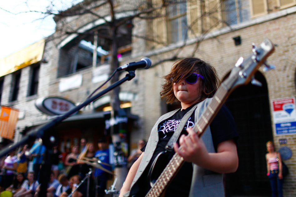 Start 'em young: Christian Brothers, from L.A., plays in the middle of the street during SXSW.