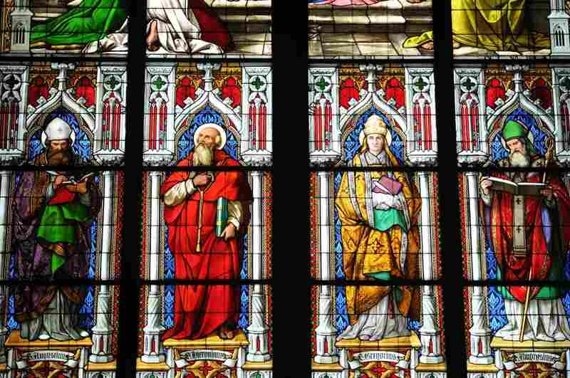 These stained glass church windows decorate the walls of the Cologne Cathedral in Germany.