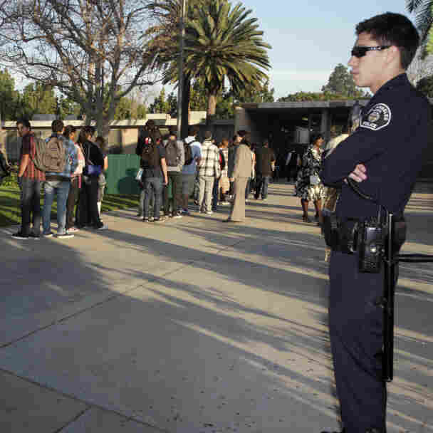 Students at Gardena High School  in Gardena, Calif., lined up for a security check before school in January 2011.