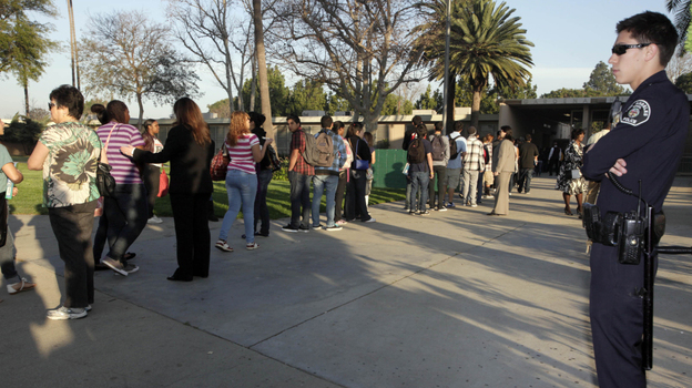 Students at Gardena High School  in Gardena, Calif., lined up for a security check before school in January 2011. (AP)