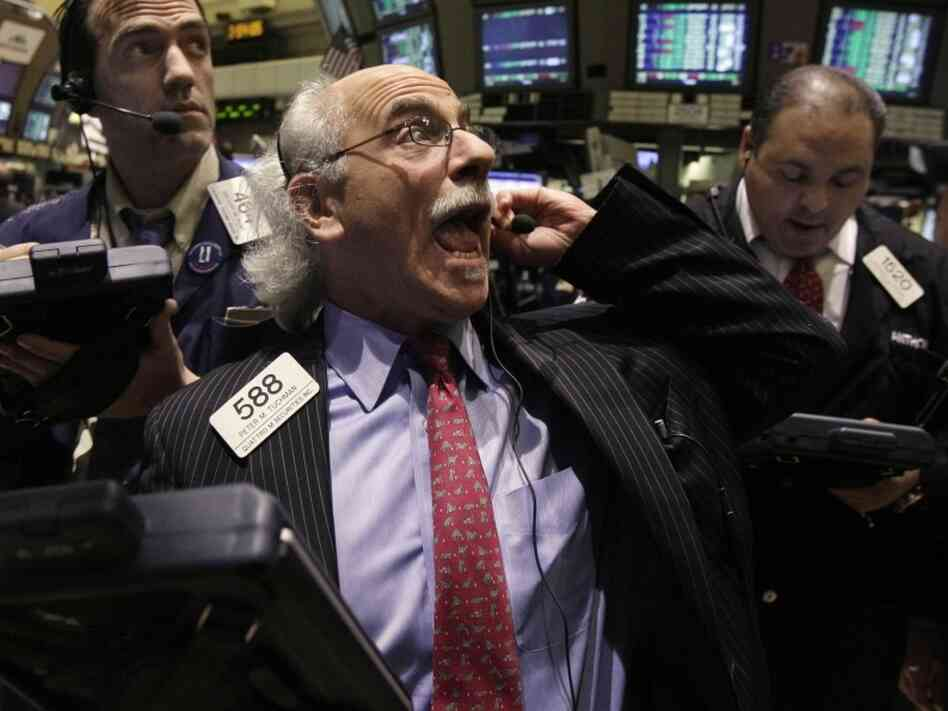 Trader Peter Tuchman reacts on the floor of the New York Stock Exchange on M