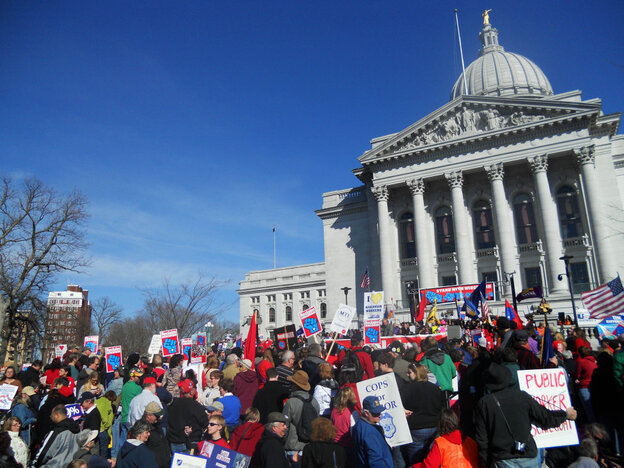 A Wisconsin GOP lawmaker facing a recall election called it quits Friday and said she hopes the state can get past scenes like this gathering of protesters in Madison