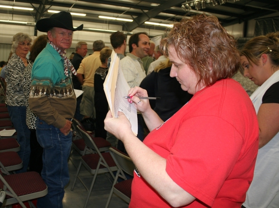 Women count votes at the GOP presidential caucus in Barry County, Mo., on Tuesday. At this and other caucuses held in the state Saturday, voters selected delegates to go to the district and state conventions.