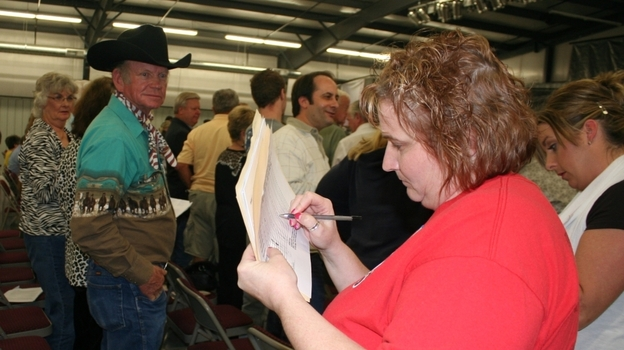 Women count votes at the GOP presidential caucus in Barry County, Mo., on Tuesday. At this and other caucuses held in the state Saturday, voters selected delegates to go to the district and state conventions. (For NPR)