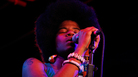 Catherine Harris-White of the hip-hop duo THEESatisfaction performs at Red 7 in Austin, Texas during the South By Southwest music conference.