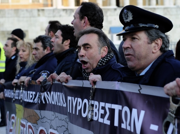Policemen shout slogans during a demonstration of Greek security forces against the new austerity measures in Athens.