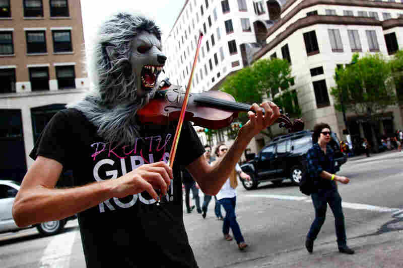 This poor guy really wanted to premiere his solo piece for violin and wolf mask, 'Lycanthropic Tendencies,' at an official SXSW showcase, but settled for the spot where A$AP Rocky marked his territory the night before.