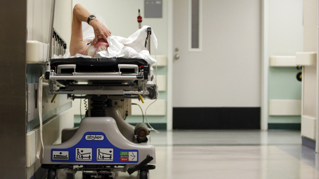 A patient waits for a room to open up in the emergency room of Houston's Ben Taub General Hospital on July 27, 2009. Nationwide, Texas has the highest rate of uninsured residents.  (Reuters /Landov)