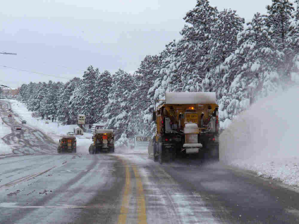 A line of snow plows clears a street on Monday in Flagstaff, Ariz. Heavy snow and high winds struck parts of Arizona on Sunday, causing hazardous driving conditions and school cancellations Monday.