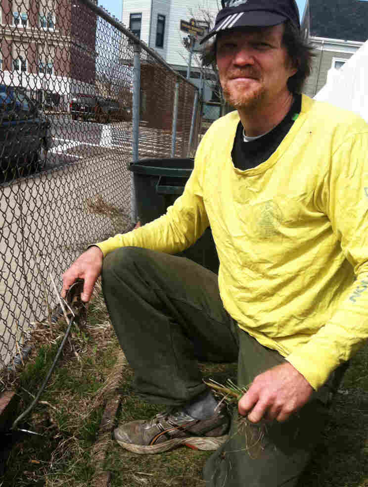Handyman Peter Brook, 51, pulls weeds outside his church in Boston. Before 2006, Brook says, he couldn't afford health care.