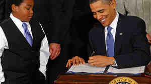 President Obama signs the Affordable Care Act in the East Room of the White House on March 23, 2010. Data suggest that racial attitudes of ordinary Americans shape both how they feel about the health care overhaul and how intense those feelings are.