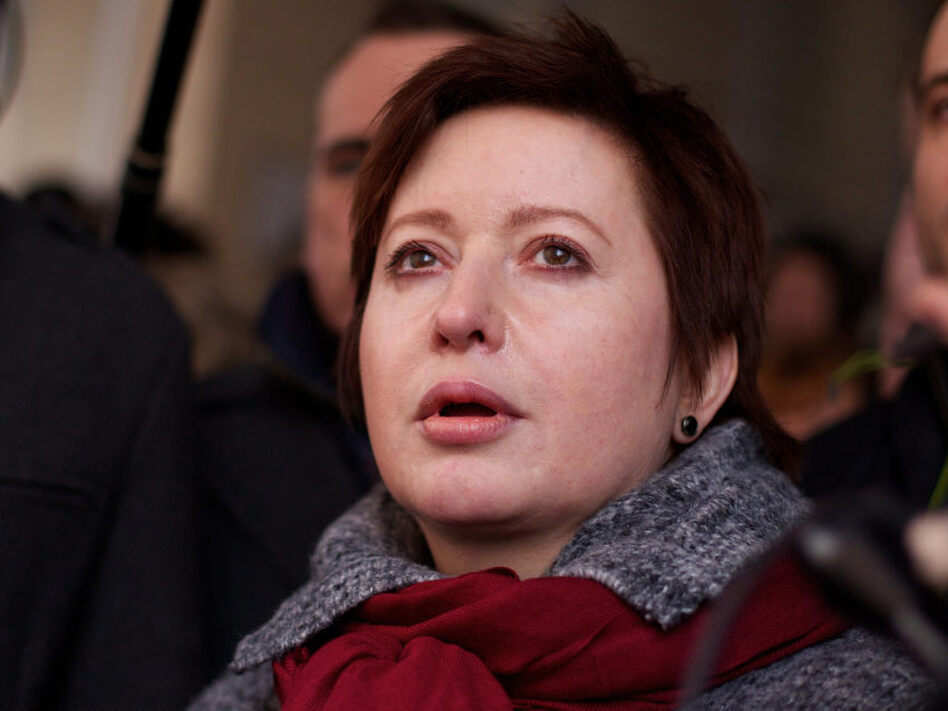 Kozlov's wife, Olga Romanova (shown here during his trial March 15), is a Russian journalist and opposition activist. (AP)