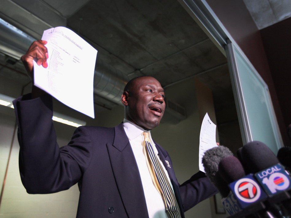 Attorney Benjamin Crump speaks to the medial, holding cellphone records and a police report. He represents the family of 17-year-old Trayvon Martin, who was was killed by neighborhood watch volunteer George Zimmerman on Feb. 26 in Sanford, Fla.