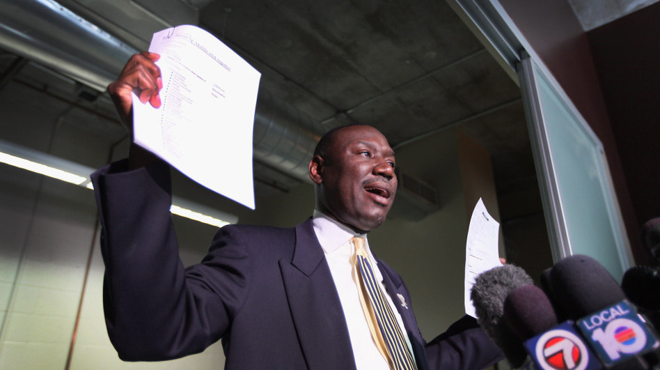 Attorney Benjamin Crump speaks to the medial, holding cellphone records and a police report. He represents the family of 17-year-old Trayvon Martin, who was was killed by neighborhood watch volunteer George Zimmerman on Feb. 26 in Sanford, Fla. (Getty Images)