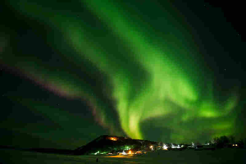 The aurora borealis swirls in the sky over the Yukon River village of Ruby, Alaska, a checkpoint of the race, on Friday.