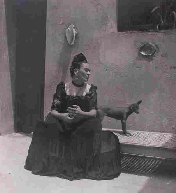 Frida Kahlo seated with dog, circa 1944.