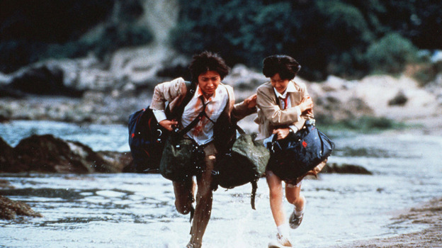 Shuya Nanahara (Tatsuya Fujiwara) and Noriko Nakagawa (Aki Maeda) are two Japanese high school students among 42 left on a deserted island, each with a bag of supplies and weapons, and forced to fight to the death in Battle Royale. (Toei / The Kobal Collection)