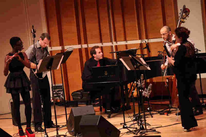 Members of the NOW Ensemble (flutist Nathalie Joachim, guitarist Mark Dancigers, Rosenfeld and Budde play Dancigers' 'Cloudbank.'.