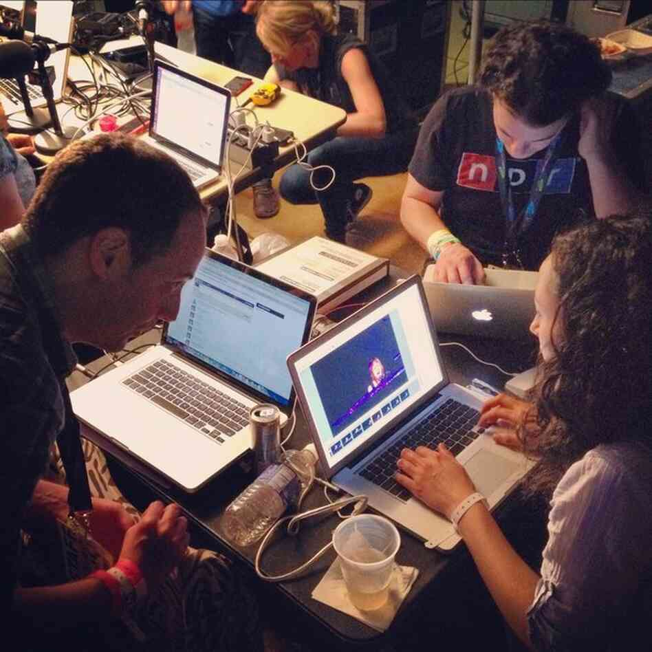 The NPR Music team hard at work between sets.