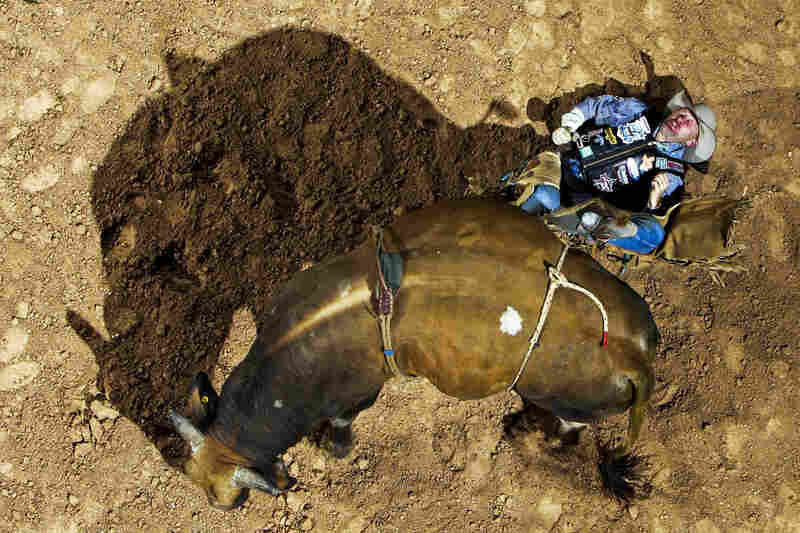 Jason Bennett lies in pain after being bucked off Jim Dippin during the Professional Bull Riders World Finals in 2006.