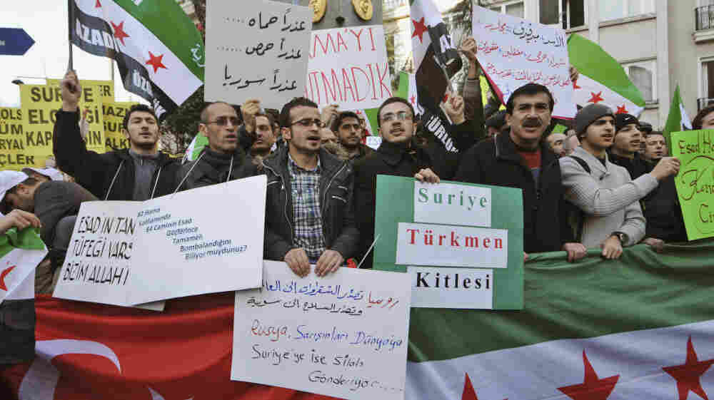 Syrians living in Turkey and human-rights activists stage a protest on Feb. 4 outside the Syrian consulate in Istanbul to condemn the killings in Syria. Calls are growing louder for Turkey to intervene in the violence in neighboring Syria by helping the rebels and civilians there.