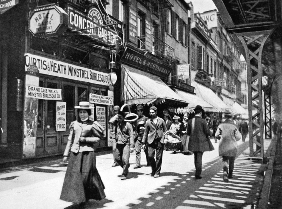 The Bowery, under the shadow of the elevated train tracks in New York City, bustled at night with colored lights and cane-swirling barkers, in places such as the Lyceum Concert Garden. (E. Idell Zeisloft/Courtesy Doubleday)