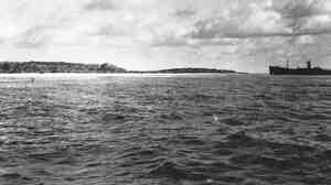 This image was provided by The International Group for Historic Aircraft Recovery. Taken in late 1937 off the South Pacific island of Nikumaroro, it interests investigators because of the object on the left side of the photo. Something is sticking out of the water. Enhanced analysis indicates that could be part of Amelia Earhart's plane, investigators say.