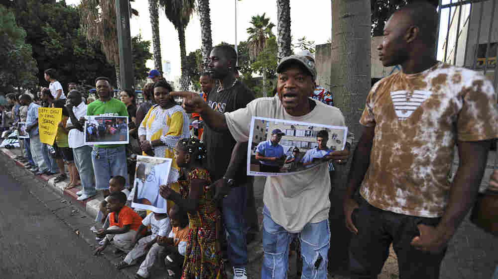 Israel says it will begin taking tougher action against illegal immigrants, many of whom are from Africa. Here, African immigrants demand the right to stay in Israel during a protest in Tel Aviv on Aug. 1, 2009.
