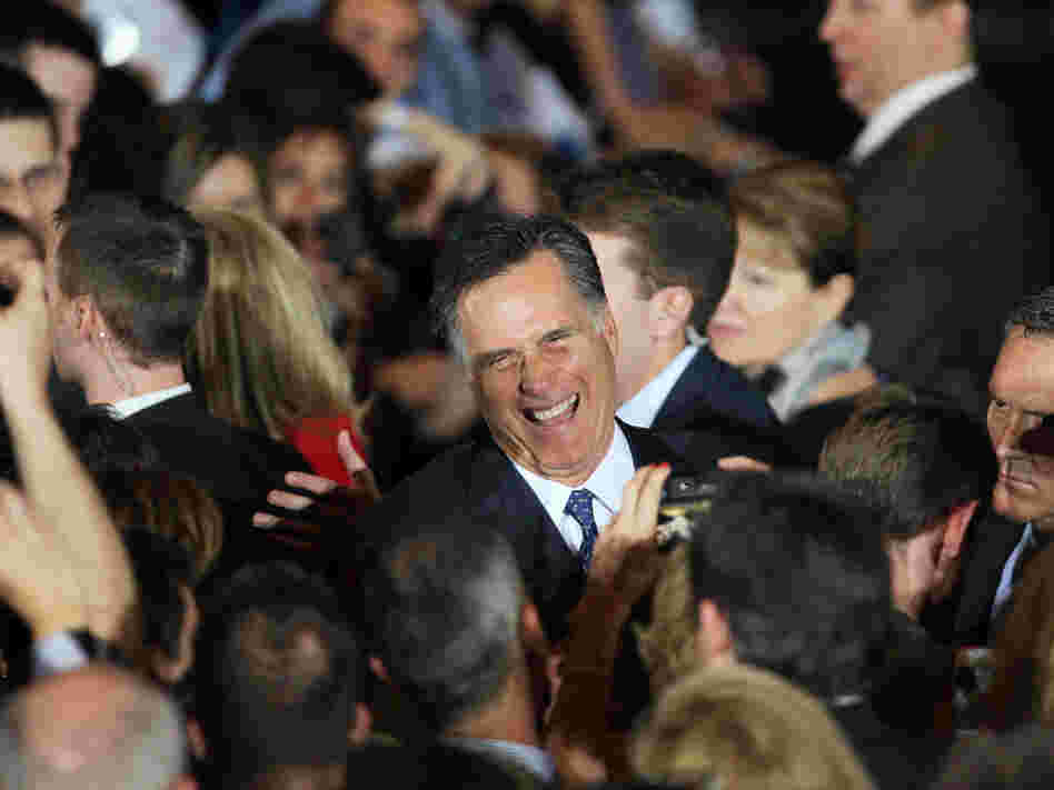 Mitt Romney greets supporters during an Illinois GOP primary victory party in Schaumburg.