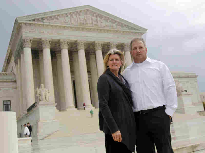 Mike and Chantell Sackett of Priest Lake, Idaho, pose for a photo in front of the Supreme Court in Washington on Oct. 14, 2011. The court ruled unanimously Wednesday that property owners have a right to prompt review by a judge of an important tool used by the Environmental Protection Agency to address water pollution.