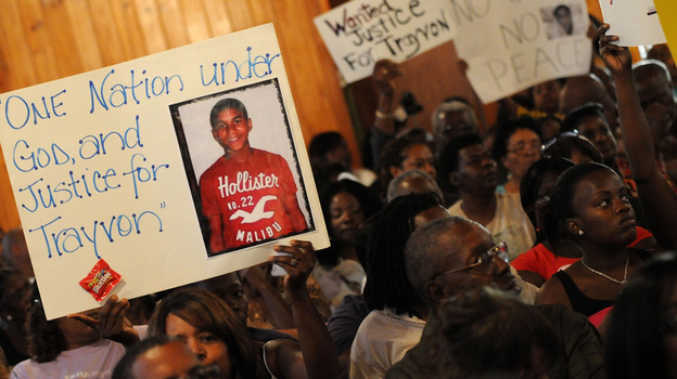 Civil rights leaders and residents of Sanford, Fla., attend a meeting Tuesday to discuss the death of Trayvon Martin, who was shot by a neighborhood watch captain. The Justice Department and the FBI opened an investigation into the shooting, and the local state attorney announced that he had asked a grand jury to investigate. (Getty Images)