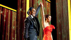 Are You Not Entertained? TV host Caesar Flickerman (Stanley Tucci) takes the celebrity interview to new lows when chatting up the young combatants in the
