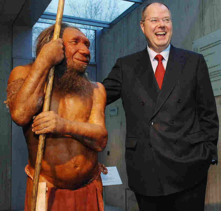 What if we still stood side-by-side? Former German Finance Minister Peer Steinbrueck poses next to a N