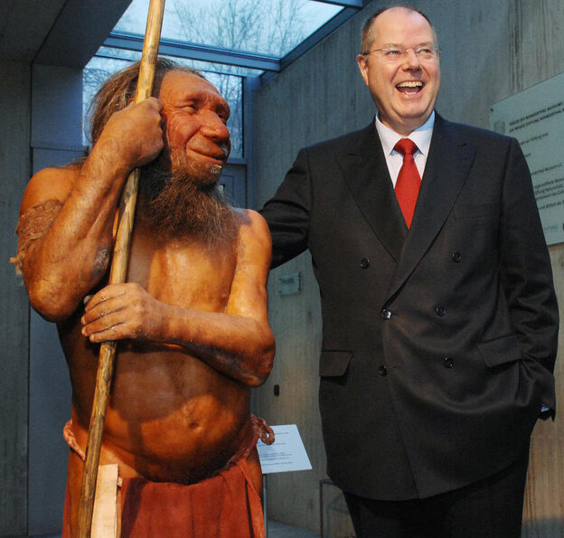 What if we still stood side-by-side? Former German Finance Minister Peer Steinbrueck poses next to a Neanderthal model at the Neanderthal Museum in Mettmann, Germany, in 2007.