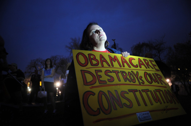 Sally Baptiste from Orlando, Fla., waits outside the U.S. Capitol for the vote on the health care bill on March 21, 2010.