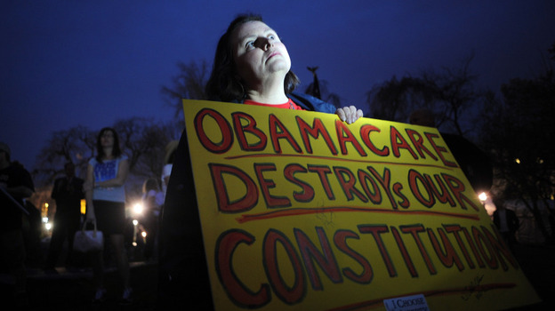 Sally Baptiste from Orlando, Fla., waits outside the U.S. Capitol for the vote on the health care bill on March 21, 2010. (Getty Images)