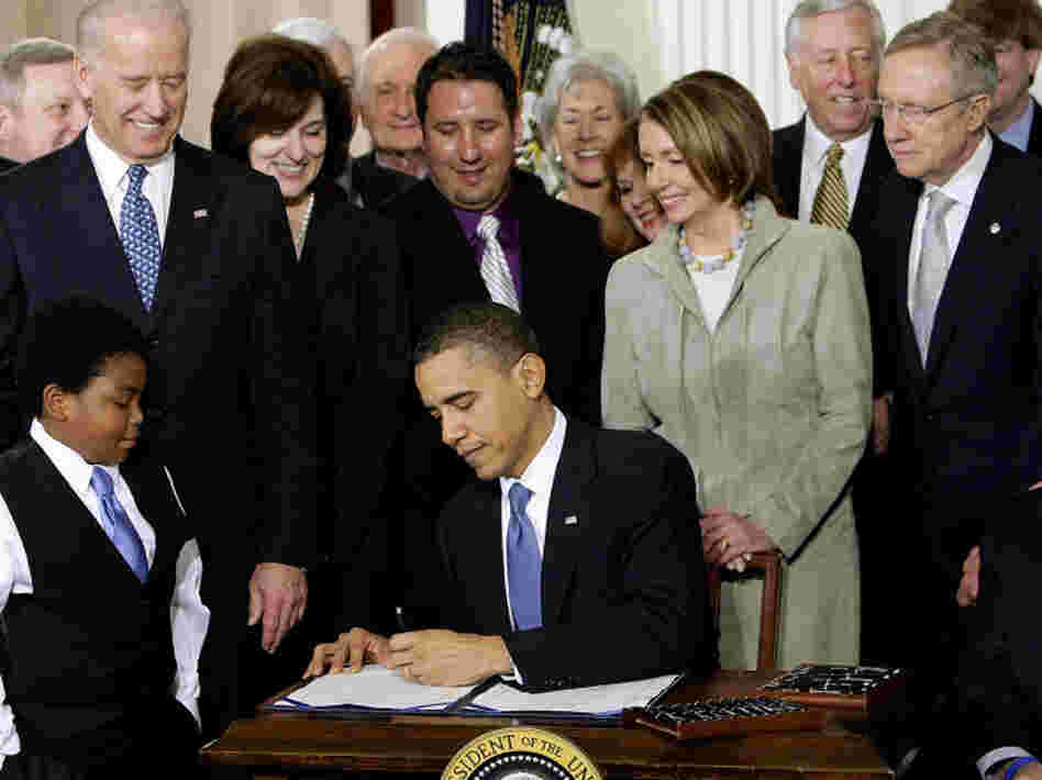 President Obama signs the national health care law at the White House on March 23, 2010.