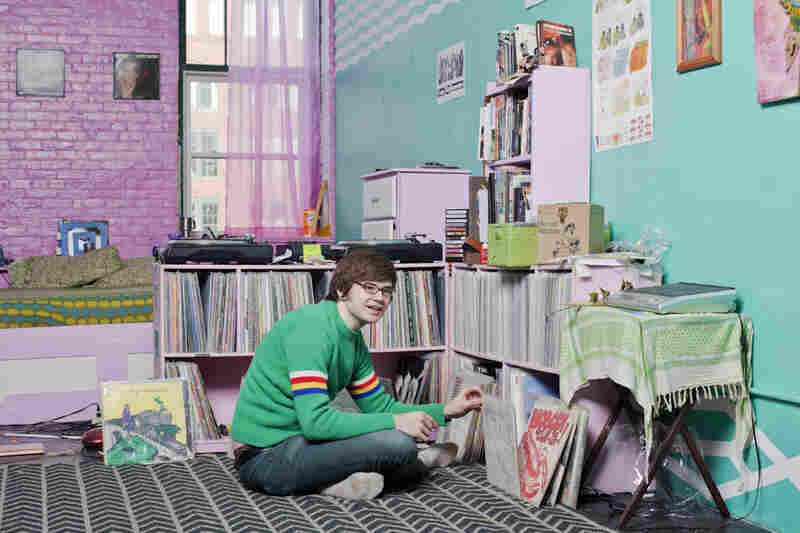 Ebbie Bonczek, 23, apt. B 302: Bonczek looks through vinyl records in his room, previously a recording studio. The B 302 loft frequently hosts loud experimental music shows and is commonly known as Str8 Cavin'.