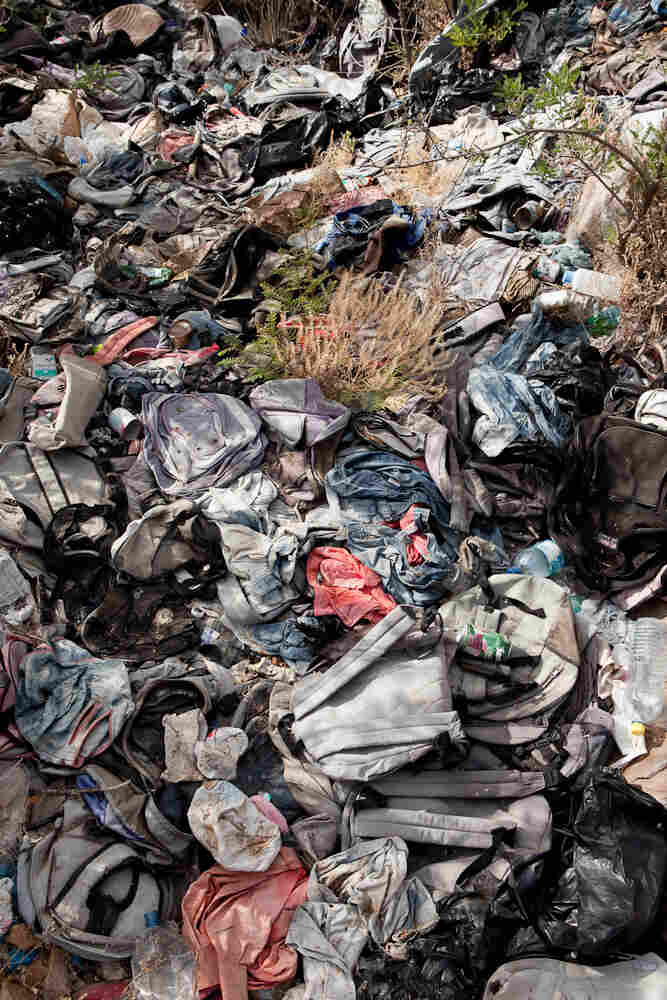 Anthropology professor Jason De Leon says migrants often leave items like backpacks behind in an effort to blend in once they make it to a bigger road or small town.