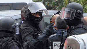 Members of a special police force unit at the site of the standoff in Toulouse, France, today.