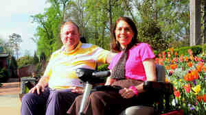 Dorothy Biebrich's red scooter helped Winslow Jackson break the ice with her back in 2006. Today the couple, shown here at the Atlanta Botanical Garden, spend their days having fun together.