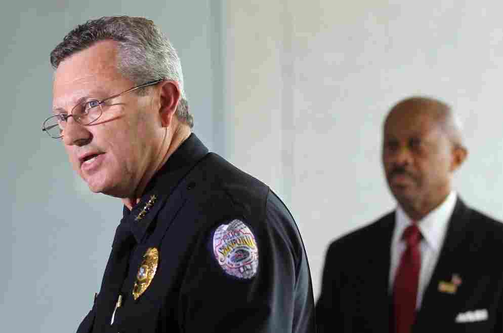 Sanford Police Department Chief Bill Lee (left) announces he will temporarily step down in the wake of the Trayvon Martin killing.