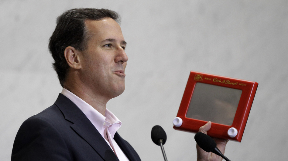 Rick Santorum beats up Mitt Romney with an Etch A Sketch, figuratively speaking.  (AP)