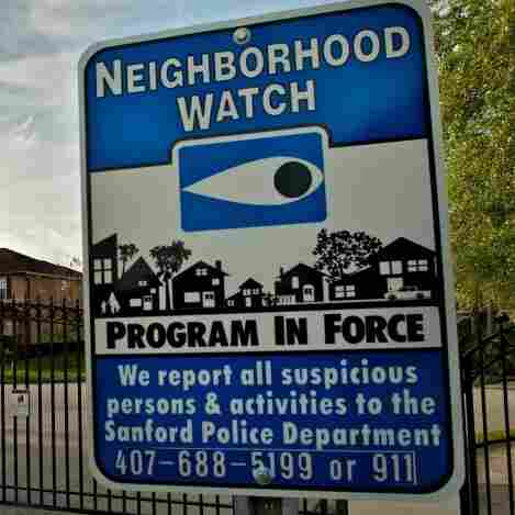A neighborhood watch sign stands outside The Retreat at Twin Lakes, the gated community in Sanford, Fla., where Trayvon Martin was shot by George Zimmerman on Feb. 26.