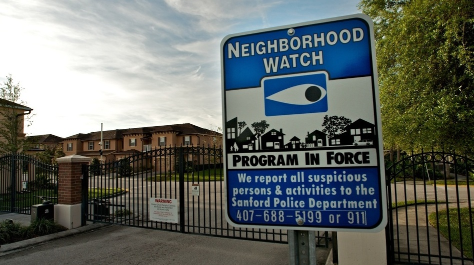 A neighborhood watch sign stands outside The Retreat at Twin Lakes, the gated community in Sanford, Fla., where Trayvon Martin was shot by George Zimmerman on Feb. 26.  (Getty Images)