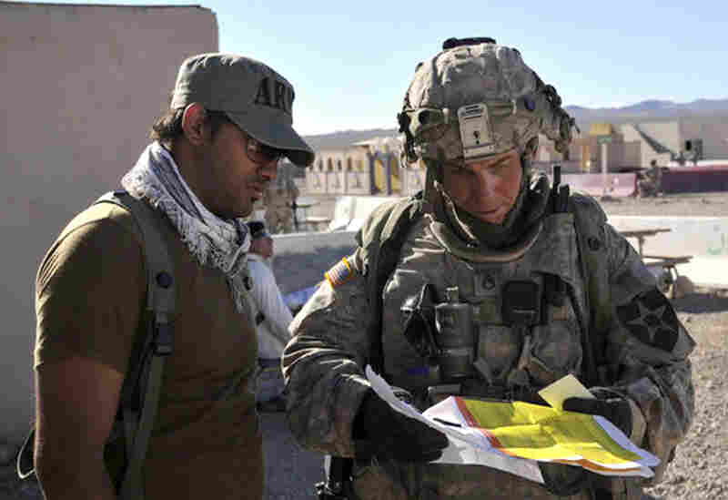 This August 23, 2011 photograph obtained courtesy of the Defense Video & Imagery Distribution System (DVIDS) shows Staff Sgt. Robert Bales (right) at the National Training Center in Fort Irwin, California. (Note at 10:50 p.m. ET: Earlier, we mistakenly said he was on the left.)