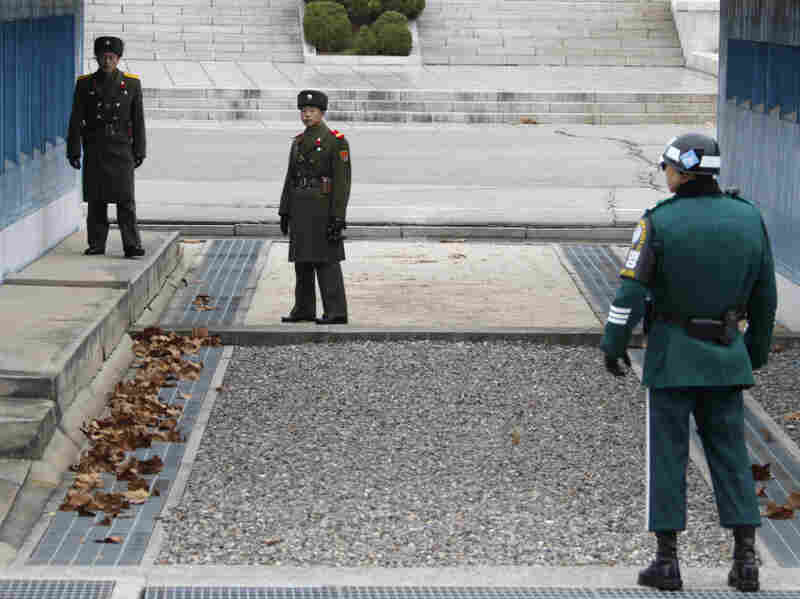 With a new leader in North Korea, the U.S. and South Korea are watching for clues of his policies. But so far tensions have not eased along the demilitarized zone. Here, two North Korean soldiers look across at a South Korean soldier on Dec. 2.