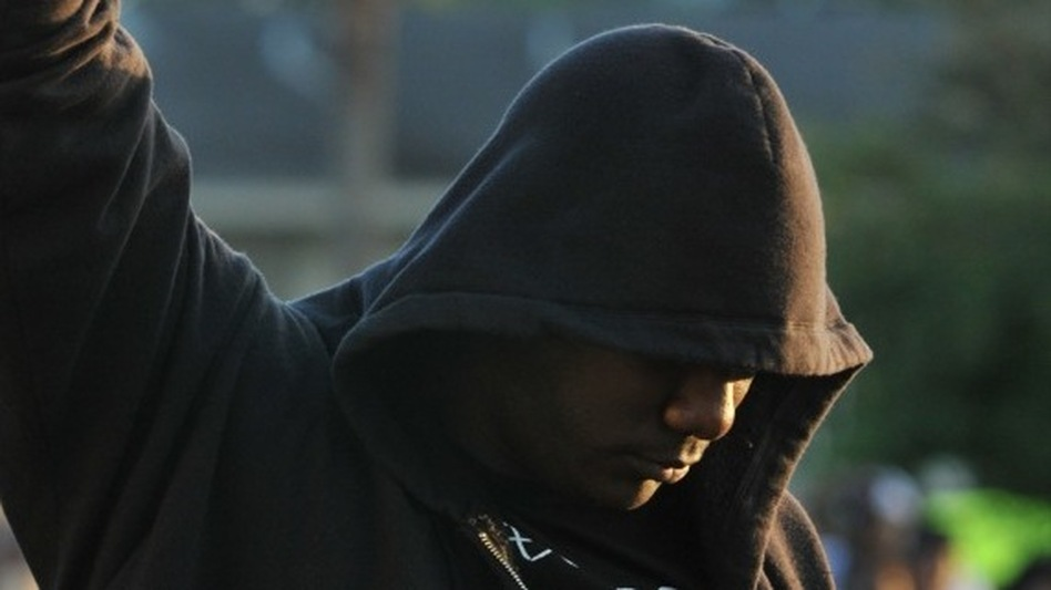 James Gilchrist of Orlando, Fla., attends a rally for slain teenager Trayvon Martin in Sanford, Fla., on Thursday. Trayvon was wearing a hoodie when he was shot. (AP)