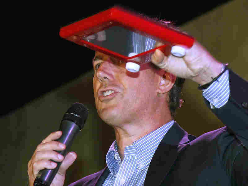 Republican presidential candidate, former Pennsylvania Sen. Rick Santorum holds an Etch A Sketch during a rally in Mandeville, La. on March 21.